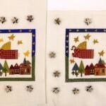 twee borduurwerkjes kerstengelen