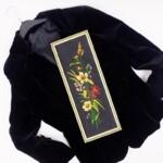 zwart jasje met borduurwerk in platsteek