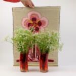 Geborduurde bloem met fluitekruid
