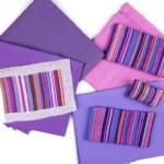 Geborduurde paarse streepjes