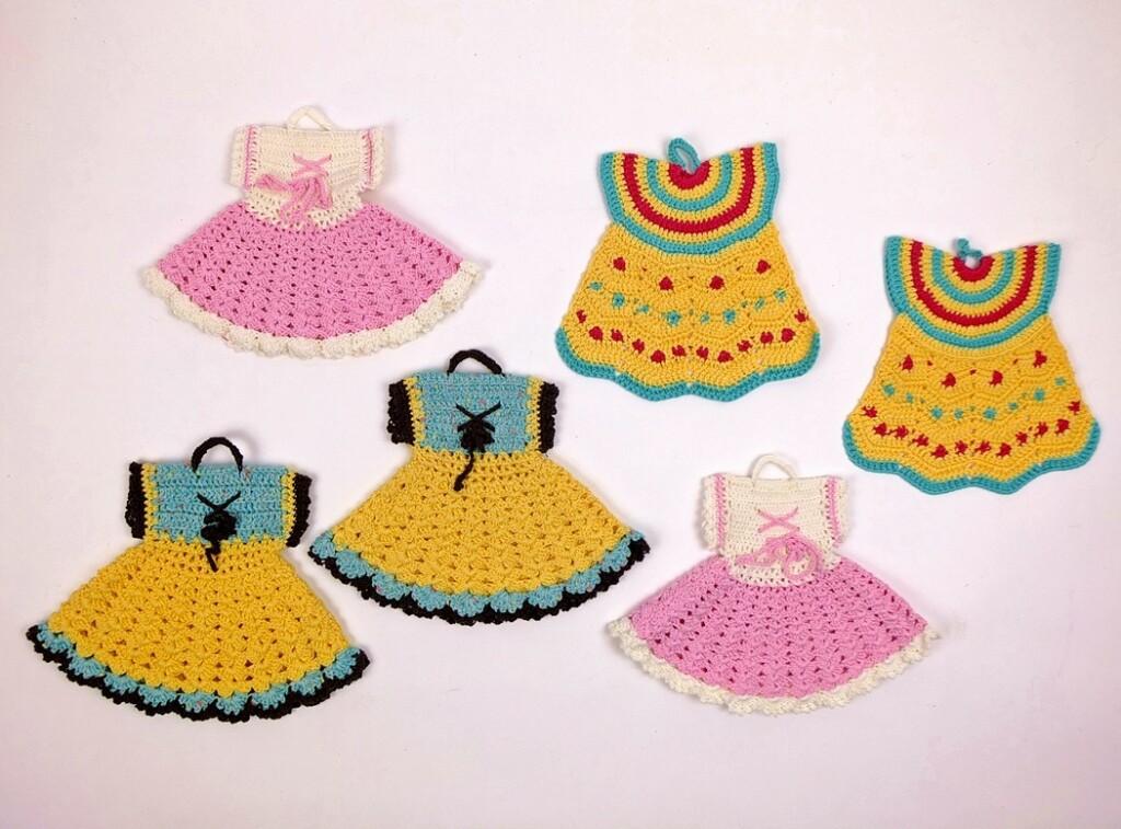 Pannelappen in de vorm van jurkjes