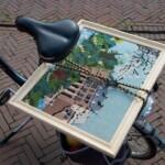 Tapisserie kasteel achterop fiets