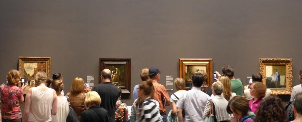 Vier schilderijen Vermeer met publiek