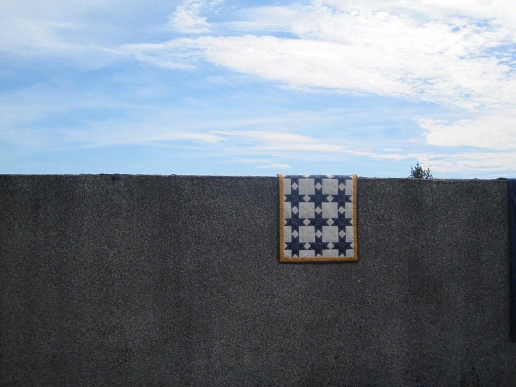 Quiltje Ohio star over betonnen muur