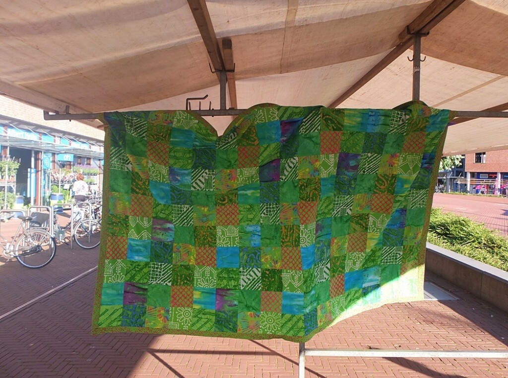 Fair trade quilt aan marktkaam
