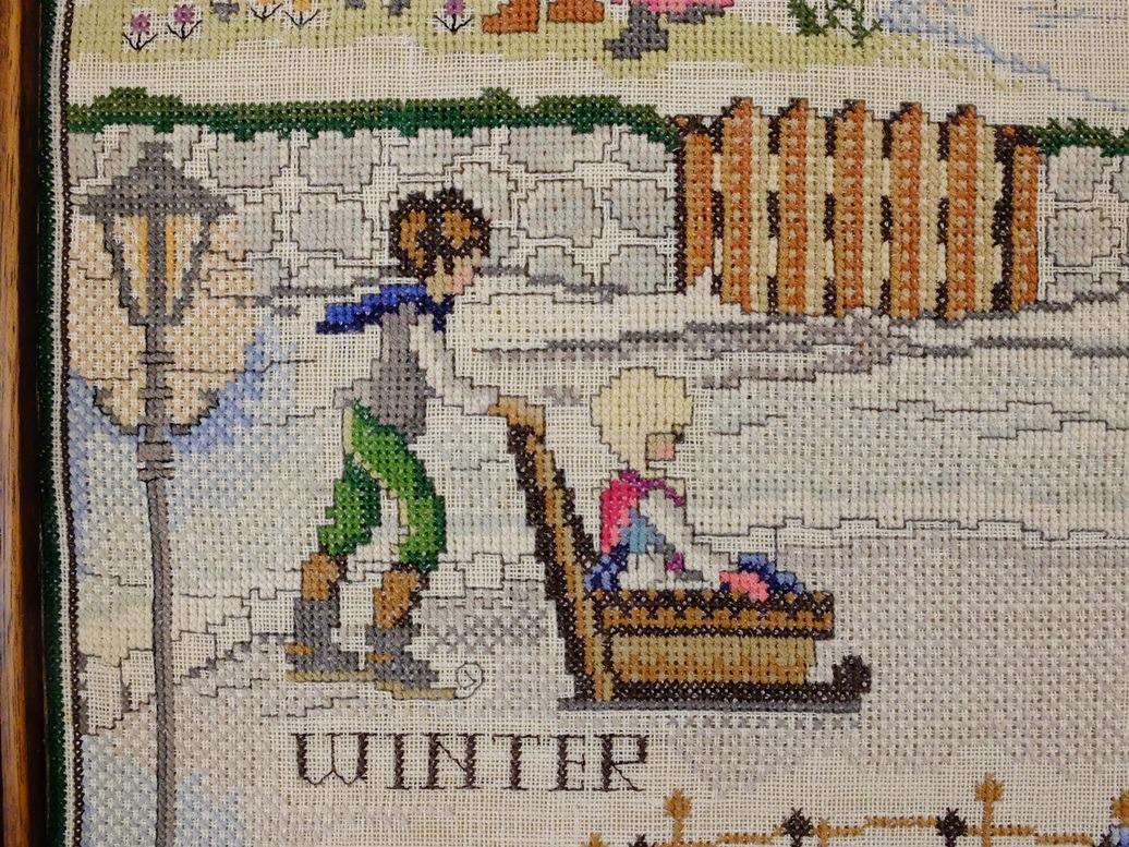 Detail borduurwerk de vier jaargetijden Winter