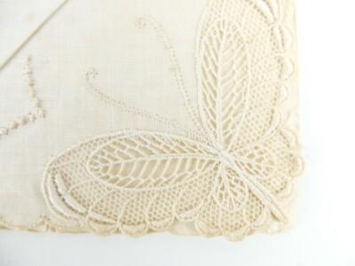 Detail oud kanten zakdoekje