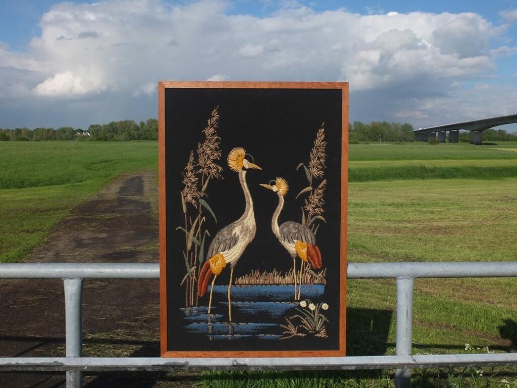 Geborduurd schilderij kraanvogels