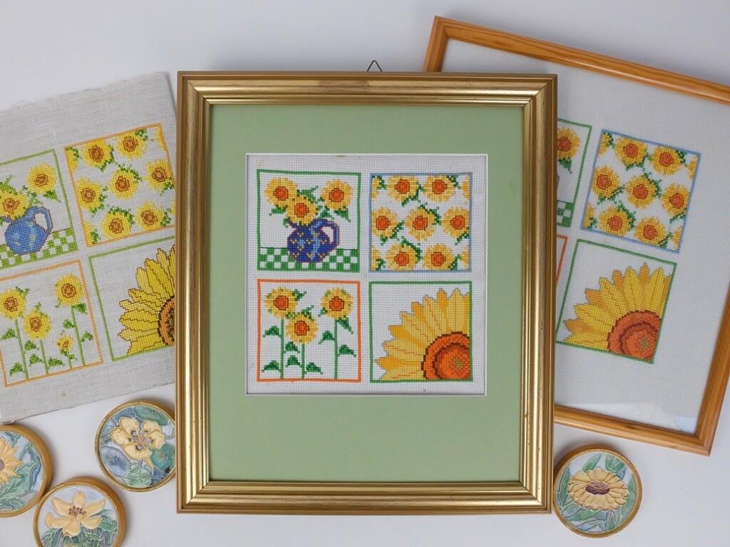 Drie borduurwerken zonnebloemen