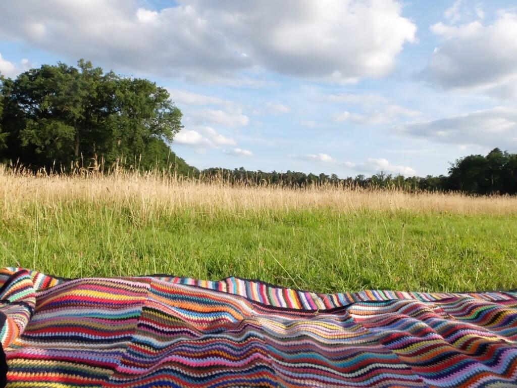 Gehaakte deken met veel kleurtjes