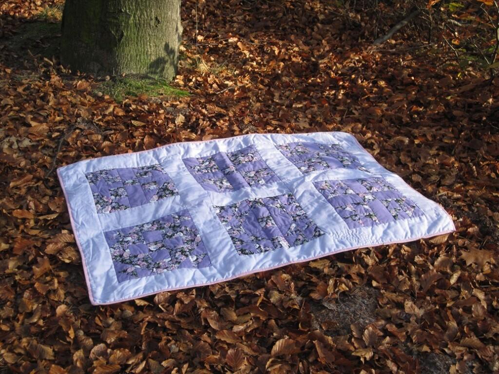 Sampler quilt in bos