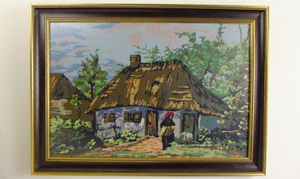 Geborduurd schilderij boerderijtje