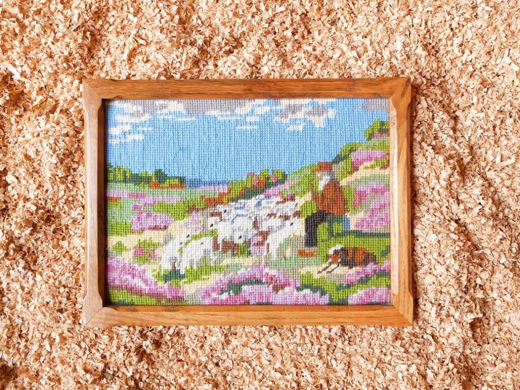 Borduurwerk herder met schapen