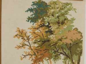 Detail bladeren borduurwerk boom
