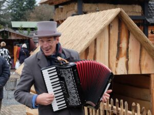 Accordeon-speler op wintermarkt