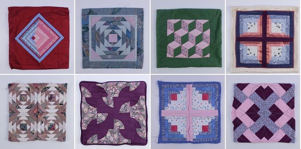 Acht patchwork kussens