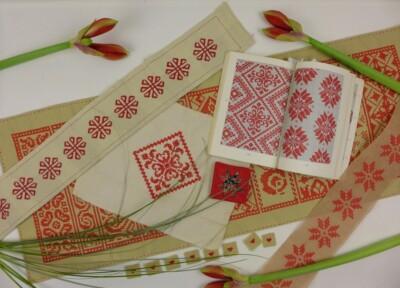 Rode borduurwerkjes en patroon voor kerst