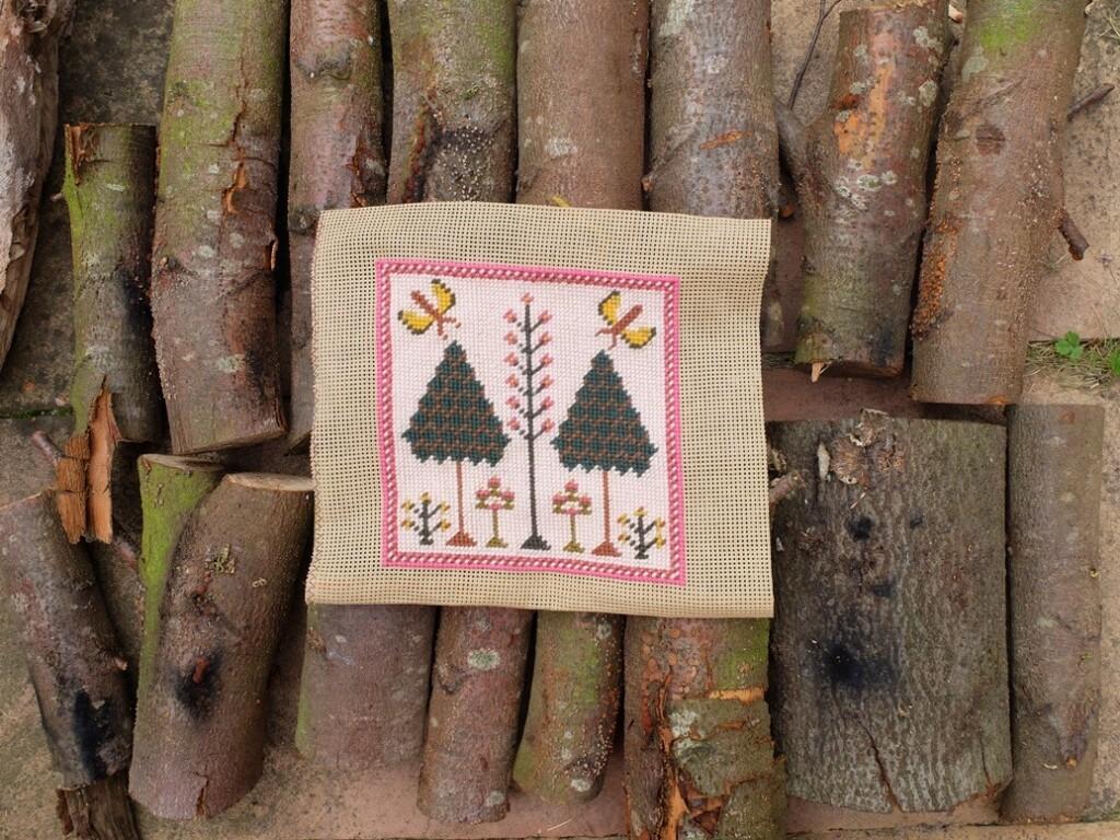 Borduurwerkje met levensbomen