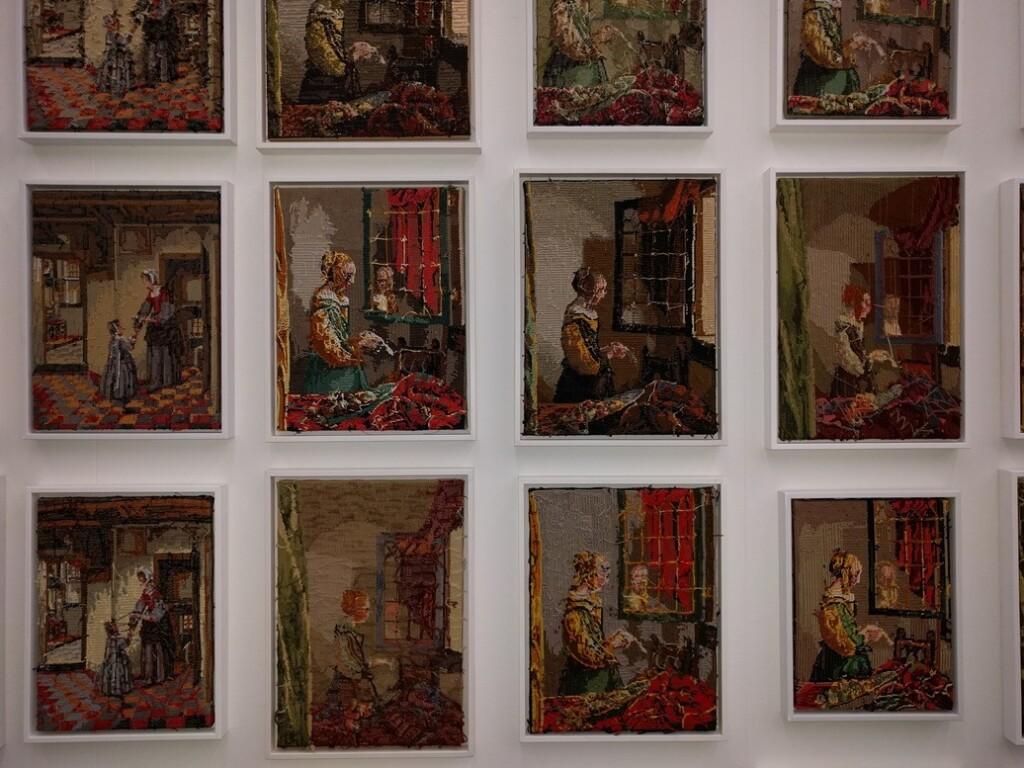 tapisserie borduurwerken brieflezend meisje bij venster